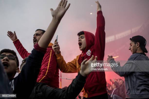 Galatasaray fans chant slogans at a training session for the Istanbul Derby match at Galatasaray Stadium on March 16, 2018 in Istanbul, Turkey. The...