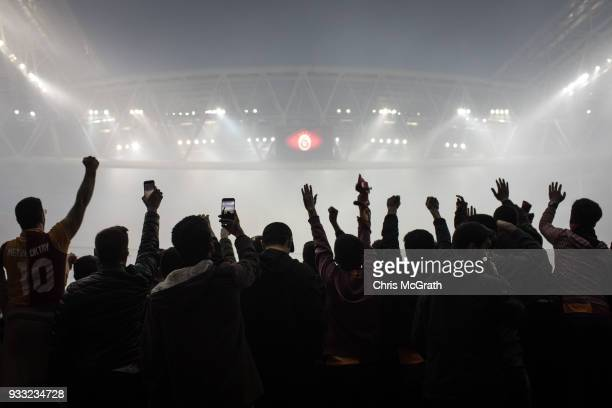 Galatasaray fans chant slogans at a training session for the Istanbul Derby match at Galatasaray Stadium on March 16 2018 in Istanbul Turkey The...