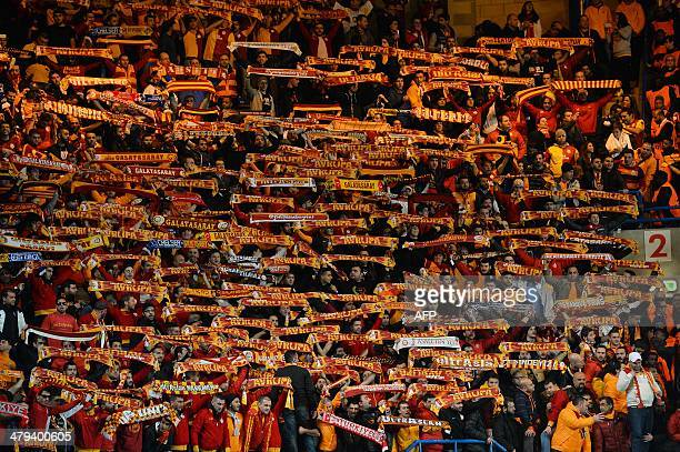 Galatasaray fans cheer for their team ahead of the start of the UEFA Champions League round of 16 second leg football match between Chelsea and...