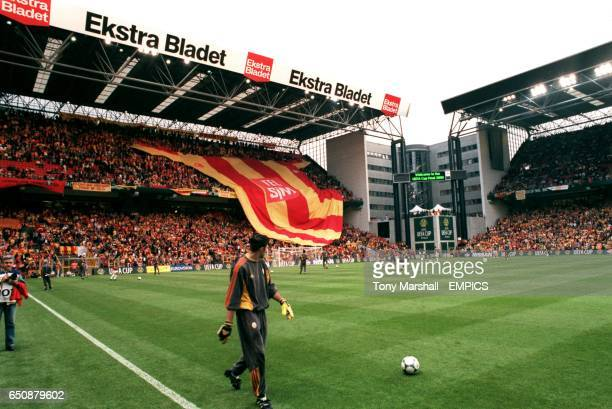 Galatasaray fans pass a huge replica shirt over their heads before the match