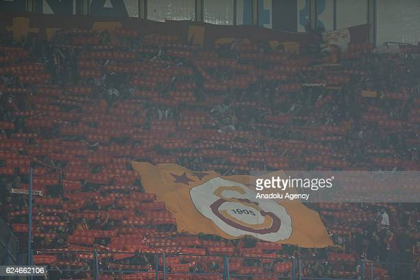 Galatasaray fans support their team during the Turkish Spor Toto Super Lig match between Fenerbahce and Galatasaray at Ulker Stadium in Istanbul...