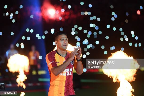 Galatasaray FC presents Colombian striker Radamel Falcao as he salutes fans during a signing cerenomy for their new transfers at TT Arena stadium in...