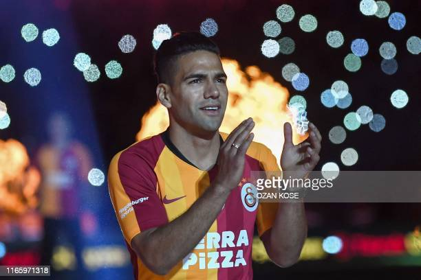 Galatasaray FC presents Colombian striker Radamel Falcao salutes fans during a signing cerenomy for their new transfers at TT Arena stadium in...