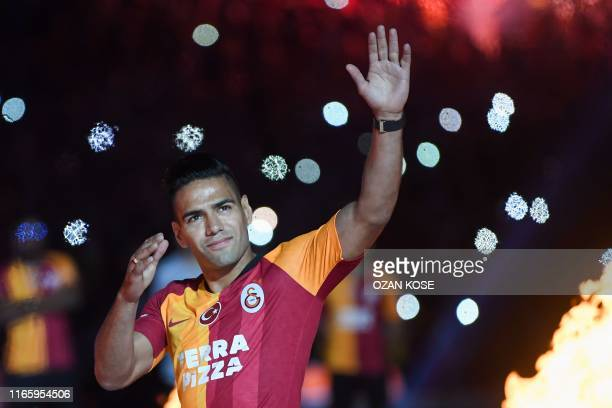 Galatasaray FC's Colombian striker Radamel Falcao waves to fans during a signing cerenomy for his new transfer at the TT Arena stadium in Istanbul on...