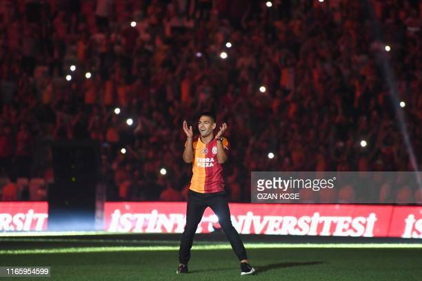 TOPSHOT Galatasaray FC's Colombian striker Radamel Falcao waves to fans during a signing cerenomy for his new transfer at the TT Arena stadium in...