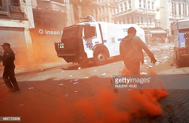 Galatasaray Fenerbahce and Besiktas clash with riot police as they protest against a new system of etickets on April 20 on Istiklal Avenue in...