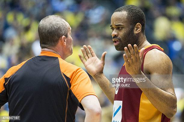 Galatasaray' forward Malik Hairston speaks with a referee during the Euroleague Top 16 group F round 8 basketball match between Turkish Galatasaray...