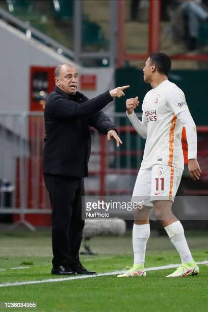 Galatasaray head coach Fatih Terim talks to Mostafa Mohamed during the UEFA Europa League Group E football match between FC Lokomotiv Moscow and...