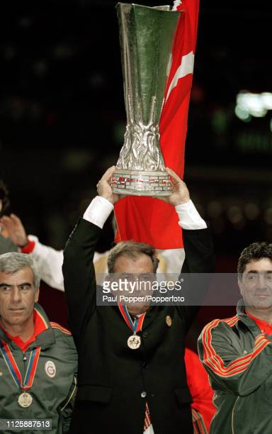 Galatasaray manager Fatih Terim celebrates with the trophy after the 2000 UEFA Cup Final between Galatasaray and Arsenal at the Parken Stadium on May...