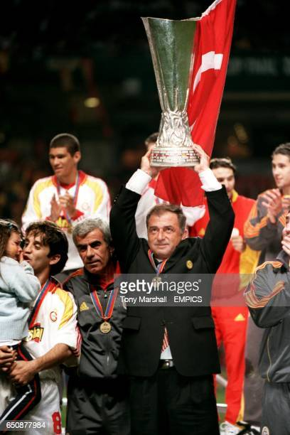 Galatasaray manager Fatih Terim celebrates with the UEFA Cup