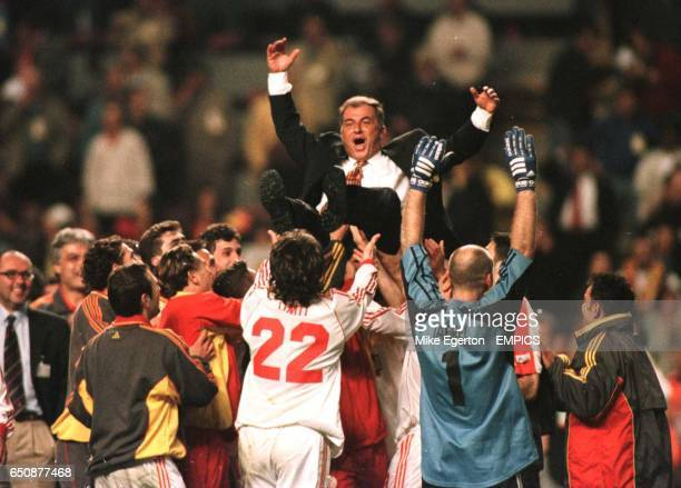 Galatasaray manager Fatih Terim is thrown into the air in celebration after the final whistle