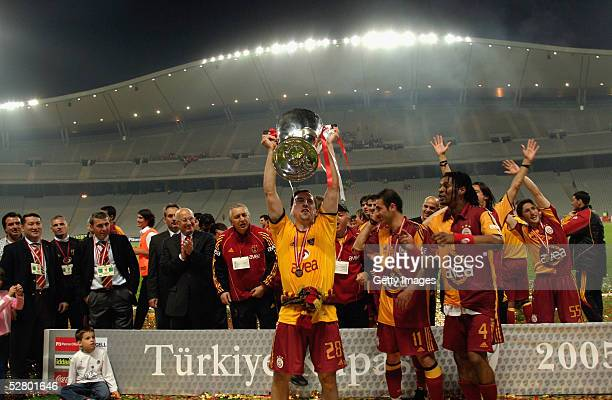 Galatasaray players celebrate winning the Turkish Cup final against Fenerbahce in Ataturk Olympic Stadium May 11 2005 in Istanbul Turkey