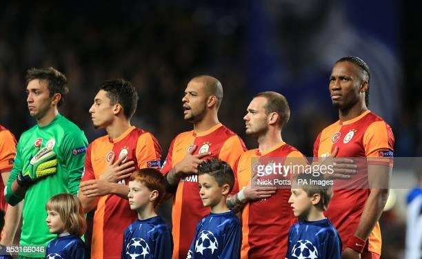 Galatasaray players line up before kickoff