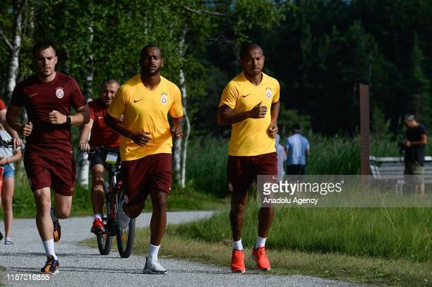 Galatasaray players Marcao and Mariano Filho are seen running around Wildsee lake during a training session within summer camp as part of the Turkish...