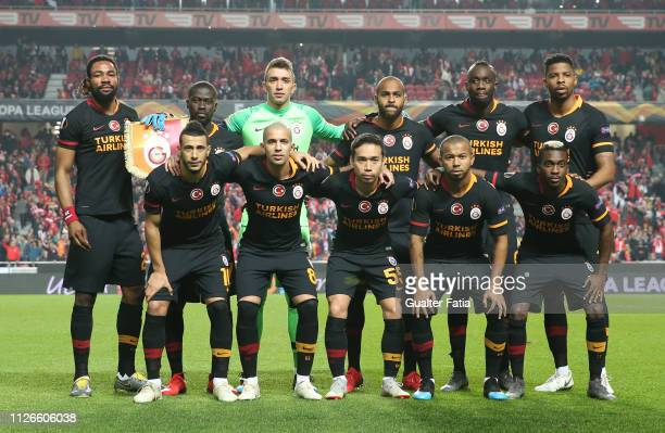 Galatasaray players pose for a team photo before the start of the UEFA Europa League Round of 32 Second Leg match between SL Benfica and Galatasaray...