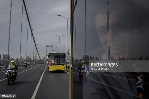 Galatasaray supporter looks out the window as the fan bus convoy crosses the Bosphurus Bridge under police escort traveling to Fenerbahce Stadium...