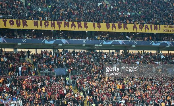 Galatasaray supporters cheer before the UEFA Champions League group A football match between Galatasaray and Real Madrid on October 22 2019 at the...