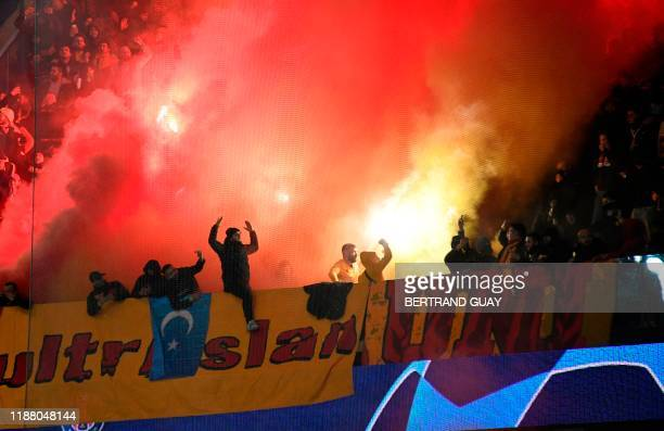 Galatasaray supporters light flares during the UEFA Champions League Group A football match between Paris Saint-Germain and Galatasaray at the Parc...