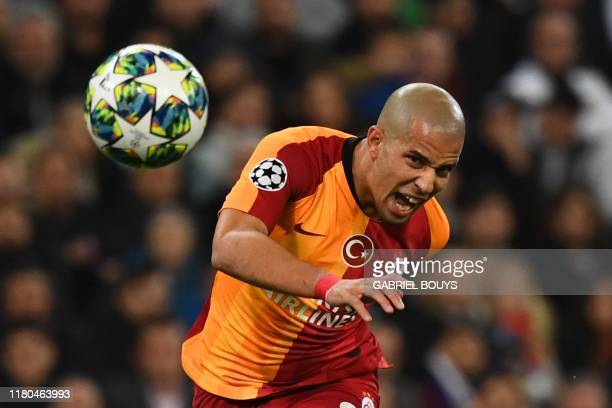 Galatasaray's Algerian midfielder Sofiane Feghouli eyes the ball during the UEFA Champions League Group A football match between Real Madrid and...