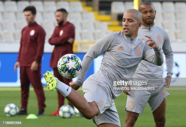 Galatasaray's Algerian midfielder Sofiane Feghouli joggles with a ball during a training session on September 17 2019 at the Jan Breydel stadium in...
