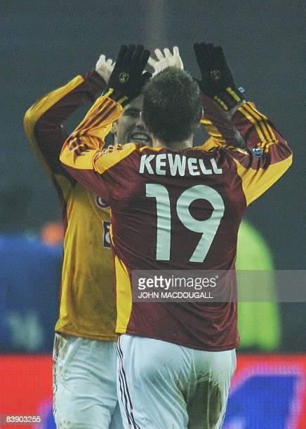 Galatasaray's Australian midfielder Harry Kewell congratulates Galatasaray's Czech striker Milan Baros after he scored during the Hertha Berlin vs...