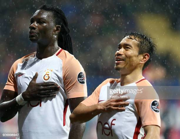 Galatasaray's Bafetimbi Gomis and Yuto Nagatomo celebrate after Nagatomo set up Gomis' goal in the first half of a 70 win away to Karabukspor in the...
