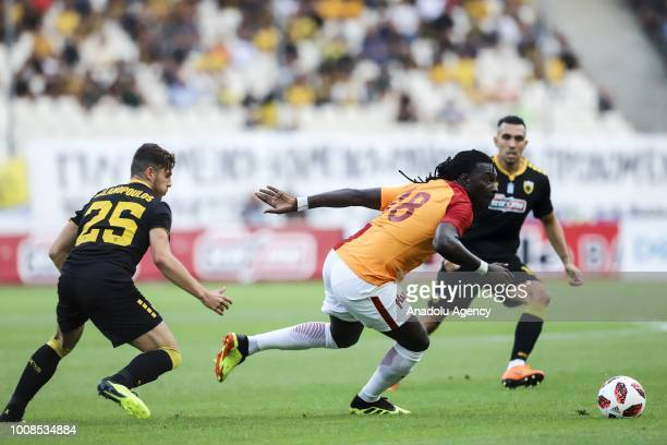 Galatasaray's Bafetimpi Gomis in action against Kostas Galanopoulos of AEK Athens during friendly football game between AEK Athens and Galatasaray in...