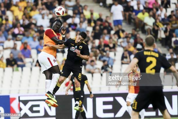 Galatasaray's Bafetimpi Gomis in action with Andre Simoes of AEK Athens during friendly football game between AEK Athens and Galatasaray in OAKA...
