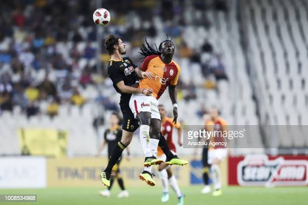 Galatasaray's Bafetimpi Gomis in action with Helder Lopes of AEK Athens during friendly football game between AEK Athens and Galatasaray in OAKA...