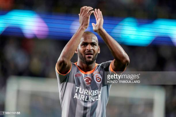 Galatasaray's Brazilian defender Marcao Teixeira greets his supporters at the end of the UEFA Champions League Group A football match between Brugge...