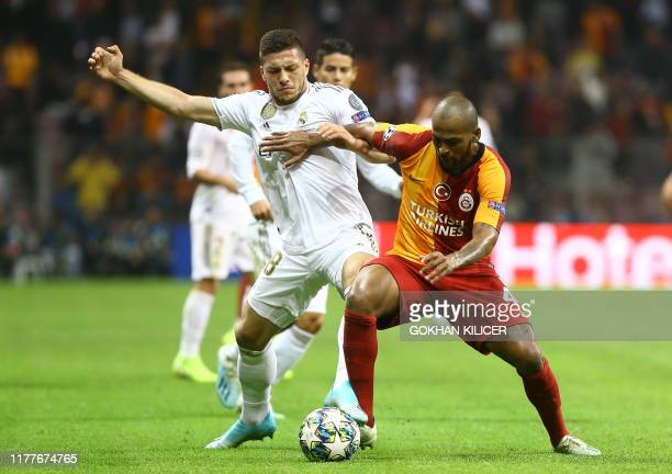Galatasaray's Brazilian defender Marcao Teixeira vies for the ball with Real Madrid's Serbian forward Luka Jovic during the UEFA Champions League...