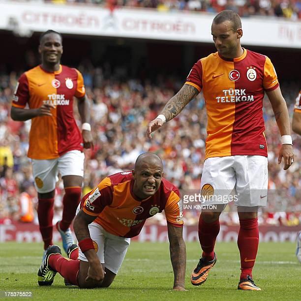 Galatasaray's Brazilian midfielder Felipe Melo reacts after scoring from the penalty spot as Galatasaray's Dutch midfielder Wesley Sneijder gestures...