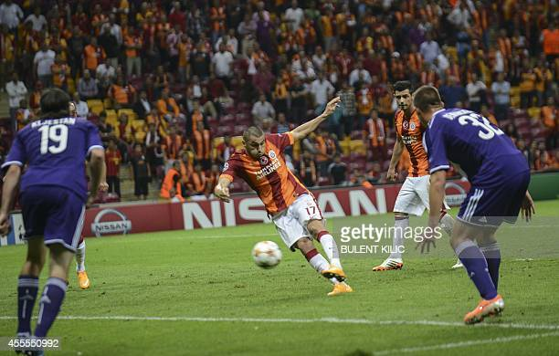 Galatasaray's Burak Yilmaz kicks his goal against Anderlecht during their UEFA Champions Leauge group D match on September 16 at TT Arena Stadium in...