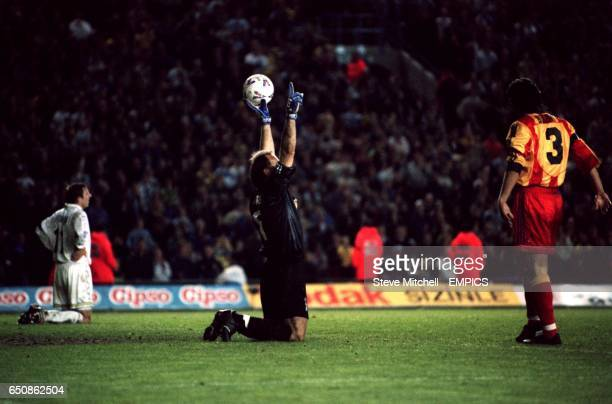 Galatasaray's Claudio Taffarel celebrates at the final whistle as Leeds United's Lee Bowyer sinks to his knees