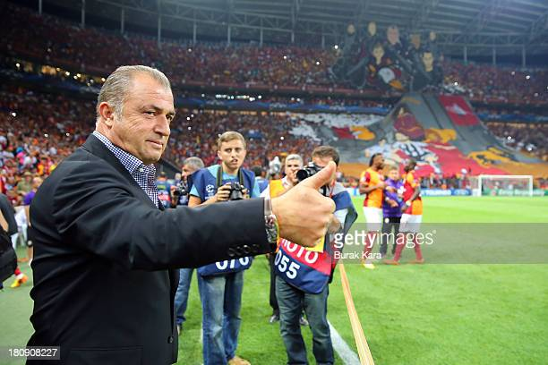 Galatasaray's coach Fatih Terim gestures during UEFA Champions League Group B match agaist Real Madrid at the Ali Sami Yen Area on September 17, 2013...