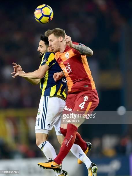 Galatasaray's defender Serdar Aziz heads the ball next to Fenerbahce's defender Hasan Ali Kaldirim during Turkish Spor Toto Super league fotball...
