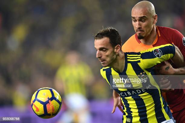 Galatasaray's defender Serdar Aziz heads the ball next to Fenerbahce's defender Hasan Ali Kaldirim during Turkish Spor Toto Super league fotball...