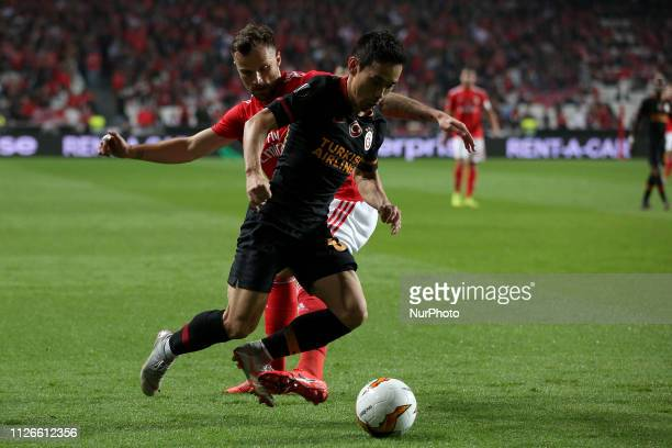 Galatasaray's defender Yuto Nagatomo from Japan vies with Benfica's Suisse forward Haris Seferovic during the UEFA Europa League Round of 32 Second...