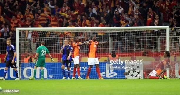 Galatasaray's Didier Drobga Eboue and Bruma celebrate after a goal during the UEFA Champions League group B match between Galatasaray vs Copenhagen...