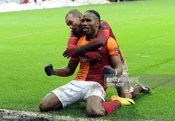 Galatasaray's Didier Drogba and Wesley Sneijder celebrates after winning against Juventus during the UEFA Champions League group B football match...