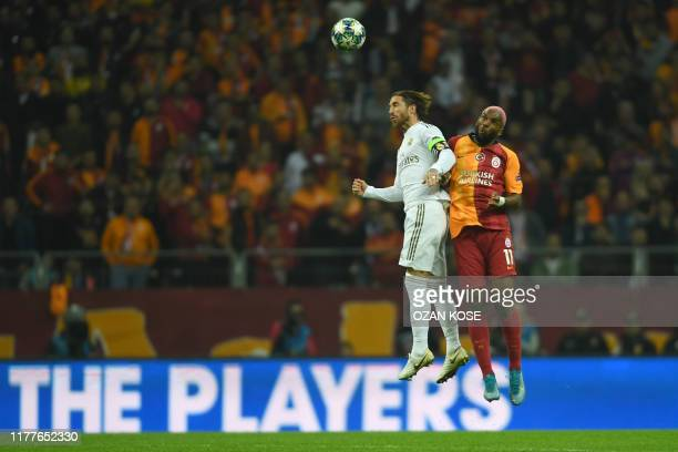 Galatasaray's Dutch forward Ryan Babel vies for the ball with Real Madrid's Spanish defender Sergio Ramos during the UEFA Champions League group A...