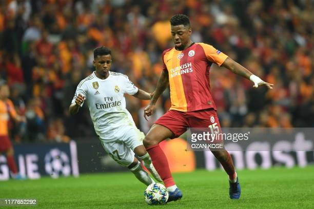 Galatasaray's Dutch midfielder Ryan Donk vies for the ball with Real Madrid's Brazilian forward Rodrygo during the UEFA Champions League group A...