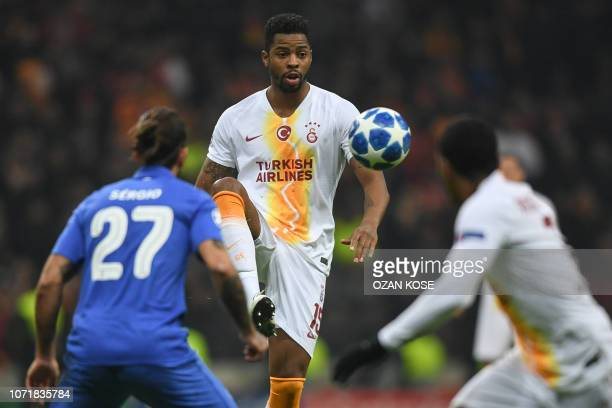 Galatasaray's Dutch midfielder Ryan Donk vies with Porto's Portuguese midfielder Sergio Oliverira during the UEFA Champions League group D football...