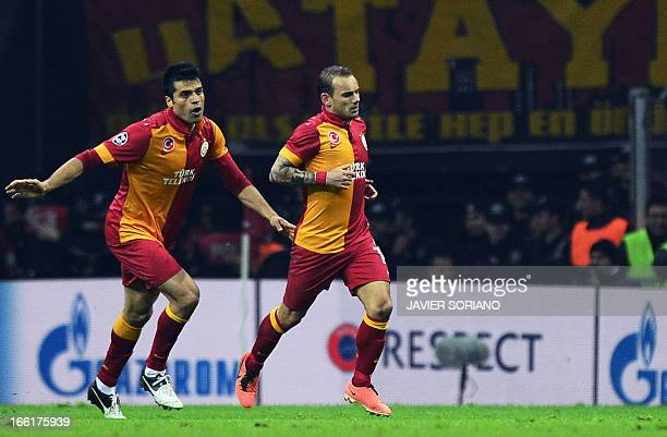 Galatasaray's Dutch midfielder Wesley Sneijder flanked by Galatasaray's defender Gokhan Zan celebrates after scoring the the second goal of the team...