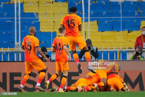 Galatasaray's Egyptian forward Mostafa Mohamed celebrates with teammates after scoring a goal during the Turkish Super League football match between...