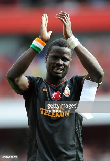 Galatasaray's Emamanuel Eboue appluads away fans after the final whistle