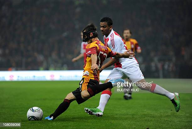 Galatasaray's Emre Colak fights for the ball with Ajax Amsterdam's Ebecilio during their friendly match at Galatasaray's new stadium Turk Telekom...