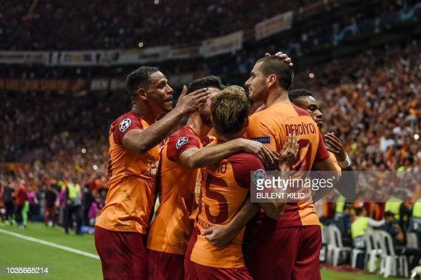 Galatasaray's Eren Derdiyok celebrates with team mates after scoring a goal during the Champions League group C football match between Red Star...