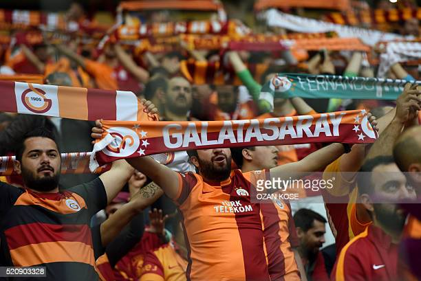 Galatasaray`s fans cheer for their team during the Turkish Spor Toto Super league football match between Galatasaray and Fenerbahce at TT arena...