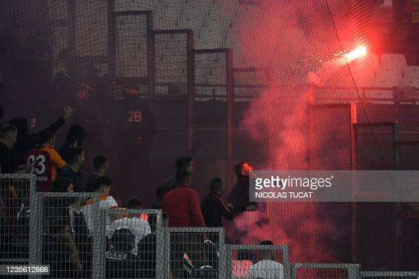 Galatasaray's fans throw a flare on the pitch during the UEFA Europa League group E football match between Olympique de Marseille and Galatasaray AS...